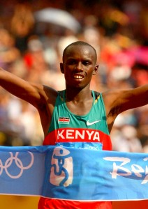 Kenya's Sammy Wanjiru celebrates as he breaks the tape to win in Beijing PHOTO/Allsports