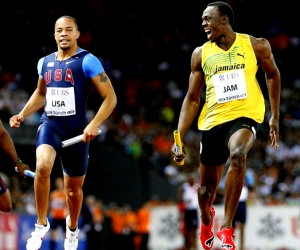 Usain Bolt (R) and American Wallace Spearmon in the relay